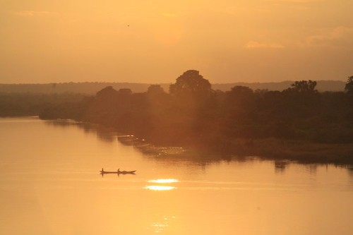 Magical sunset over Black Volga River, Central Ghana.
