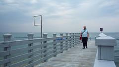 triste, solitario y final (duineser) Tags: blue sea man pier friend mare cloudy ale2000 deck slovenia capodistria slovenija azzurro molo koper nuvoloso