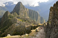 Machu Picchu from the Guard House (Alex E. Proimos) Tags: world life camera cloud house mountain castle heritage tourism peru rain machu picchu inca clouds train sunrise work trek walking wonder four office site agua ruins day tour evacuation walk citadel anniversary board guard dream cost tourist tourists unesco pesos repair valley landslide 100th take express safe months behind helicopters orient expensive mudslide job floods orientexpress urubamba huayna incan advisor mudslides calientes perurail torrential wina wayna urumbamba adviser evacuating triggered intheclouds flickraward pachacuti proimos machupicchus100thanniversary