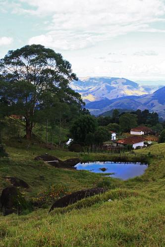 blue brazil grass green house lake landscape mountain reflection rocks
