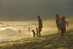 There is always one moment in childhood when the door opens and lets the future in (itala2007) Tags: ocean sunset beach childhood waves itala2007 mastersgallery worldsartgallery