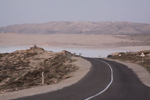 Cycling into the mist. Near Tamri, Morocco.
