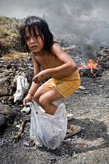 Stung Meanchey Dump Site, Cambodia - Scavenger Girl (Mio Cade) Tags: girl work fire site kid garbage cambodia child poor dump social dirty rubbish environment phnom scavenger stungmeanchey