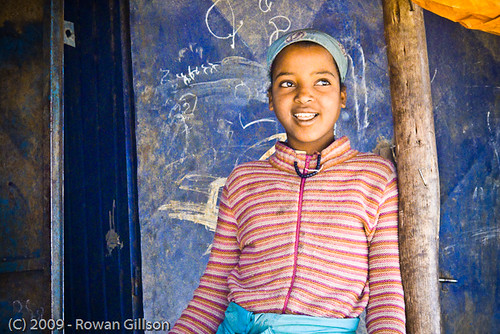 A young girl pauses from selling produce for a quick portrait in Addis Ababa, Ethiopia.