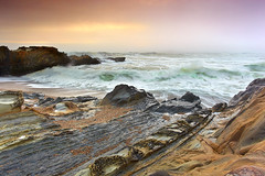 Primordial Sea - Pebble Beach, San Mateo County, California (PatrickSmithPhotography) Tags: ocean california travel blue sunset red sea vacation sky usa seascape beach nature rock fog landscape sand sandstone pacific wave pebbles pebble pebblebeach bec halfmoonbay sanmateo sanmateocounty tufoni