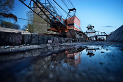 Crane Reflection (Notley) Tags: bridge sunset sky reflection water colors clouds ro river boat crane glasgow rivire missouri april tug reflexion reflexin missouririver howardcounty reflectoin  2011 10thavenue odraz glasgowmissouri notley ruralphotography daisybell eftertanke notleyhawkins missouriphotography httpwwwnotleyhawkinscom notleyhawkinsphotography