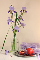Exquisite (panga_ua) Tags: iris red stilllife beautiful beauty canon purple availablelight pomegranate ukraine seeds fabric exquisite delicate tabletop irises bodegon sense artisticphotography naturamorta intoxicating blueflowers glassbottle artphotography sharpfocus punicagranatum metaltray nataliepanga exquisitepicture