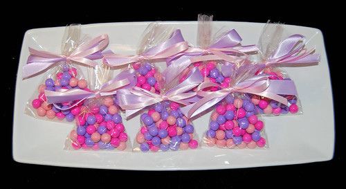 pink and purple sixlet party favors