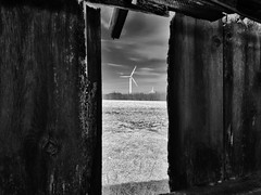 the arrival... (BillsExplorations) Tags: windturbine windfarm windmillwednesday windowwednesday weatheredwindow weathered abandoned forgotten decay ruraldecay rural abandonedillinois abandonedfarm rusted illinois ohio hww arrival windenergy blackandwhite monochrome