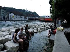 River Reuss (Helen M Turner) Tags: bridge summer people wall river switzerland rocks riverbank lucerne