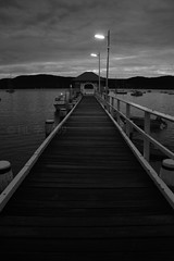 Dusk at Palm Beach (fotoeins) Tags: travel bw cloud white black water canon eos lights pier dusk jetty sydney kitlens australia quay landing wharf nsw newsouthwales palmbeach lightfixture xsi northernbeaches eos450d 450d canonefs1855mmf3556is fotoeins henrylflee