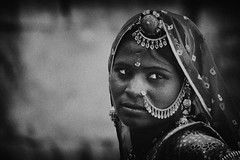 A Moment of My life (Anirudh..) Tags: street travel costumes portrait bw music india macro slr art nature monochrome lady female photoshop work canon eos rebel lights idea costume insane asia close natural zoom expression traditional culture experiment sigma retro 300mm adobe dresses passion concept xs tradition dslr colorless diva jaipur jaisalmer rajasthan krishnan 70300 agarwal anirudh filmeffect anirudhagarwal 1000d