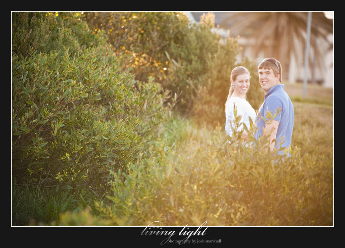 Couple portrait amongst shrubbery in King Edward Park, Newcastle.