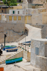 Malta and the Cat (Ana Santos) Tags: cat boats europe malta anasantos summer2009 anaalmada