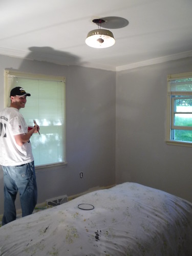 Tom painting the guest bedroom by you.