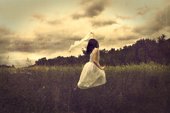 FOREVER (SCOTT GUSTKE) Tags: fling girl field grass clouds vintage photography flickr alone child frolic dress antique flight running run best mirth forever prairie bliss glee flail