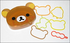 Rilakkuma Rubber Band (applel0ve) Tags: container dango 2009 rubberbands rilakkuma sanx kiiroitori kumashaped 18pieces remotecontrolduck fs94201