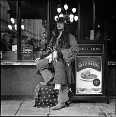 Captain Jack Sparrow eats pies at the White Lion (sixbysixtasy) Tags: street portrait bw 6x6 film pose garden jack costume pub artist drink hasselblad covent sparrow pirate pies actor mf analogue piratesofthecaribbean hasselblad500cm