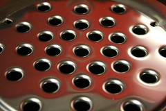 BBQ (Alesa Dam) Tags: red abstract color reflection oneaday metal closeup canon metallic bbq holes barbecue photoaday pictureaday project365 400d challengeyouwinner canoneos400d challengewinner 69365 thepinnacle20120629