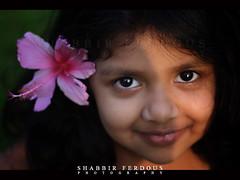 Little Flower Girl (Shabbir Ferdous) Tags: portrait flower girl smile female photographer shot hibiscus sylhet bangladesh bangladeshi canonef50mmf18ii canoneosrebelxti shabbirferdous wwwshabbirferdouscom shabbirferdouscom