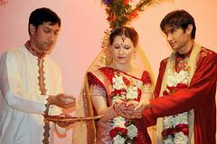 Feeding the Fire (Gori Girl) Tags: flowers wedding red india groom bride mixed couple indian garland hindu bengali interracial intercultural