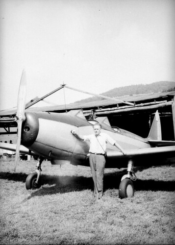 Man with two seat light plane