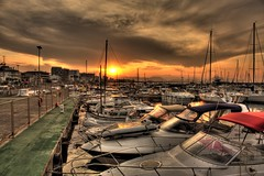 Sunset over safe harbour, Mallorca, Balearic Islands, Spain ( HDR ) (kgka00) Tags: lighting travel sunset sea sky sun detail reflection tree green water colors yellow clouds contrast canon dark island eos islands bay is dock spain europe exposure honeymoon ship harbour background ships tripod playa espana destination 1855mm effect mallorca palma hdr tenger tengerpart seacoast baleares exposures palmademallorca balearicislands balearic balears illesbalears islasbaleares tonemapped tonemap photomatrix 3exposures 450d canon450d balearislands hdrbackground seahdr baol moreexposures