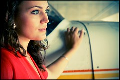 At the Hangar II (Stefan G.) Tags: red portrait people woman girl beautiful face tarmac photoshop plane canon airplane switzerland eyes dress cross aircraft gorgeous hangar lifestyle portraiture processing thun berne cessna airstrip airfield allmend sigma1770mm eos40d