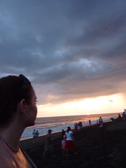 Me looking at the sun setting over the sea.