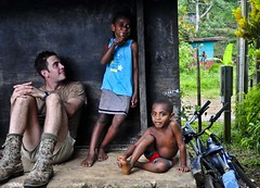 Sapper Jonathan Buttery sits with ni-Vanuatu children (Department of Defence) Tags: army engineer humanitarian adf vanuatu australianarmy sapper australianregulararmy australiandefenceforce
