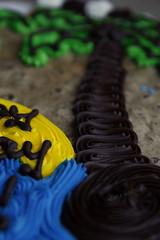 Switchbacks (Tiny_ninja) Tags: birthday blue brown green yellow cake yummy cookie chocolate palmtrees birthdaycake icing swirl frosting cookiecake greatamericancookiecompany
