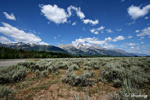 A wide-angle shot of the Grand Tetons in Wyoming