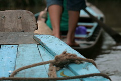 Row Row Row Your Boat (Rainedom) Tags: sunset sky people colors fruits animals canon children fun boat coconut rich culture vietnam swamp rides hcmc mekongriver vungtao 400d rainedom rainescape