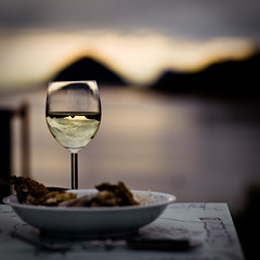 Whitewine, crumbed coalfish and the sunset (Tord...) Tags: sunset norway norge bokeh norwegen explore lesund canoneos5d canonef85mmf18usm prinsencamping