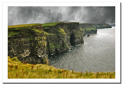 The Cliffs of Moher (3). Ireland.- (ancama_99(toni)) Tags: ocean trip travel blue ireland light sea vacation sky irish cliff paisajes naturaleza holiday seascape color green beach nature water rock azul clouds photoshop landscape geotagged photography mar photo agua nikon rocks europa europe clare waves photos playa photographic irland eire cliffs atlantic scenary layers cliffsofmoher paysage paesaggi olas atlanticocean 2009 emeraldisle aigua moher attraction atlntico irlanda paisagens irlande oceano 1000views atlantico ocano d60 acantilados eireann republicofireland 50faves landschaftsaufnahmen abigfave p1f1 theunforgettablepictures ancama99 7naturalwonders saariysqualitypictures