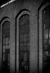 steam plant (flee the cities) Tags: old windows bw industrial arch bricks panes structure kansascity missouri steamplant archway powerplant solid windowpanes fossilfuels plateglass archedwindows coalplant wellbuilt veoliaenergy