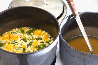 risotto with butternut squash and mustard greens cooking