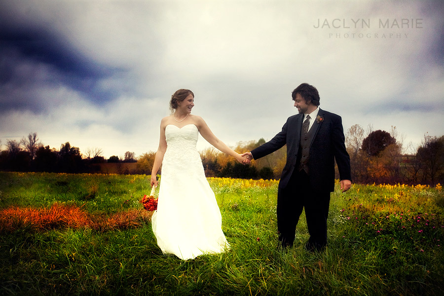 Bride and groom photo in a field with wildflowers