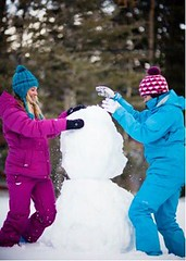Two young women building snowman (nigel67) Tags: winter woman white mountain snow cute sexy sports girl smile snowman pretty expression coat young teens teen skilift blond blonde brunette skis blondehair youngwoman jumpsuit snowsuit teenage 20s skigoggles skiwear teenagegirl onepieceskisuit