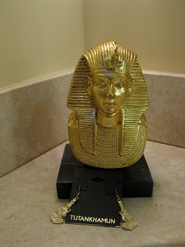 Cool Tut Swag. Dont laugh, the bust is surprisingly well made with a marble base. Perfect for holding up that commemorative hardback of the exhibit catalog.