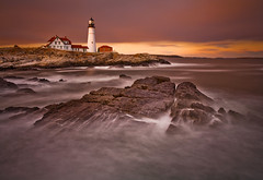 Fiery Lighthouse (chris lazzery) Tags: longexposure sunset lighthouse maine explore 5d frontpage portlandheadlight capeelizabeth cascobay canonef1740mmf4l bw30nd