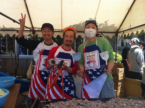 "Local volunteers serve up fried ""Udon"" noodles with slices of U.S. pork at a shelter housing 260 people in the city of Kesennuma."