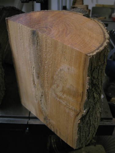Jacaranda log resawn in half and shown in 3/4 view