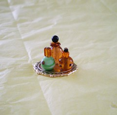 Bewitched Vanity ~ 1:12th Scale (Enchanticals ~I'm Coming Back) Tags: autumn orange woman black green halloween glass gold miniature beads handmade vanity hobby autumncolors clear dressingroom opaque tray swirls collectible etsy ornate delicate homedecor oval enchanted dollhouse dioramas findings powderroom toiletries stoppers littlethings originaldesign warmcolors goldtone perfumebottles roombox oneinchscale 112scale roomboxes 112thscale dollhouseminiature onetwelfthscale etsyartists etsyteams minimakers goldtray damteam scaledollhouseminiature teammids enchanticals miniaturedollhousescale minitreasures enchanticalsetsy miniaturesindollhousescale minaturesgeneral