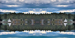 Symmetrical Face Off (Philerooski) Tags: trees houses two panorama lake storm mountains reflection clouds photoshop boats mirror washington waves pano digitalart double symmetry wa symmetrical ripples split faceoff sailboats middle showdown flipped dejavu diamondlake philerooski
