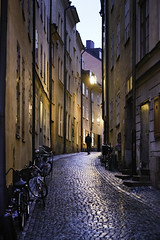 Kpmanbrinken (Hannes R) Tags: street city houses light house man reflection lamp rain bike bicycle reflections walking evening town streetlight sweden stockholm bikes cobblestones bicycles cobble cobblestone gamlastan oldtown kpmanbrinken