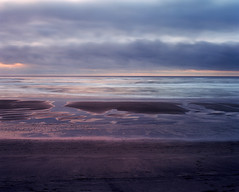 Sand, surf, sea and sky (Zeb Andrews) Tags: ocean sunset color film beach oregon landscape coast sand horizon pacificocean pacificnorthwest oregoncoast westcoast neskowin pentax6x7 bluemooncamera kodakektar100 zebandrewsphotography
