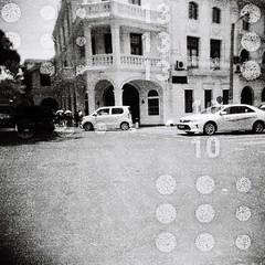 Kandy corner (sonofwalrus) Tags: srilanka kandy asia blackandwhite bw street cornedr building architecture cars windows