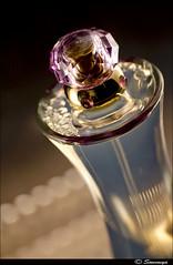 happiness is like perfume ($owmya) Tags: india home canon bottle photographer perfume bokeh flash perspective gift setup elegant sow versace strobe sowmya strobist 400d canon400d remotetrigger 70300sigma cactusv2 vivatar285hv owmya
