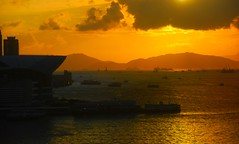 Hong Kong Orange (Let Ideas Compete) Tags: china light sunset red sea orange holiday mountains silhouette yellow clouds port island hongkong islands bay harbor colorful cloudy harbour south ships silhouettes sunsets center victoria adventure glorious exposition busy stunning metropolis shipping metropolitan enhanced hdr southchinasea expocenter greatcity densecity inspiredbyyourbeauty